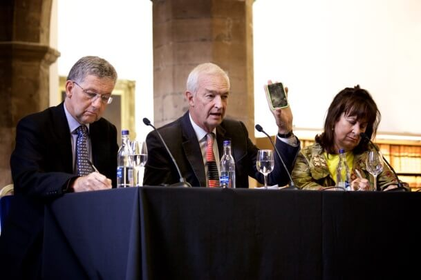 Media and law panel. Jon Snow holds up a cracked mobile phone.